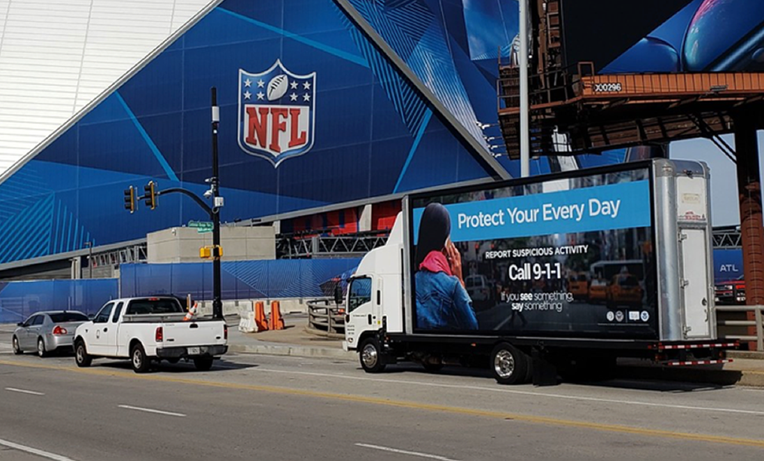 SeeSay Mobile Billboard driving by Mercedes Stadium